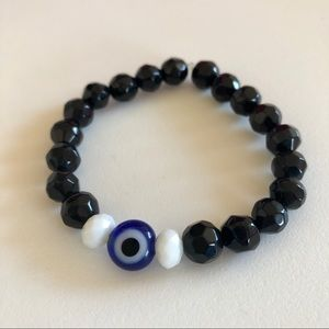 Black, white and evil eye glass stretch bracelet